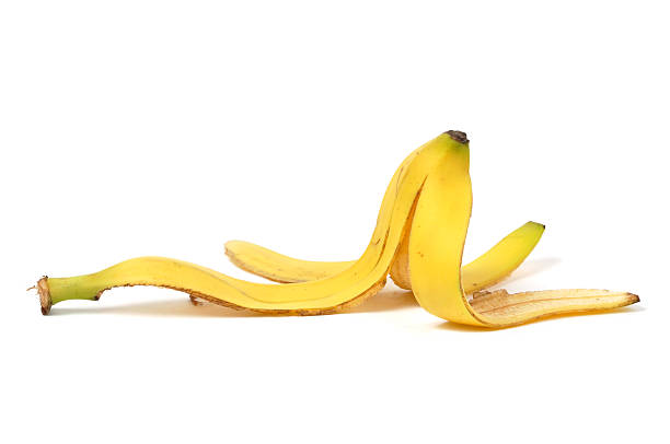 Banana Skin Banana skin isolated on white background banana peel stock pictures, royalty-free photos & images