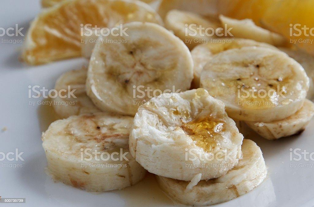 Banana slices with honey stock photo