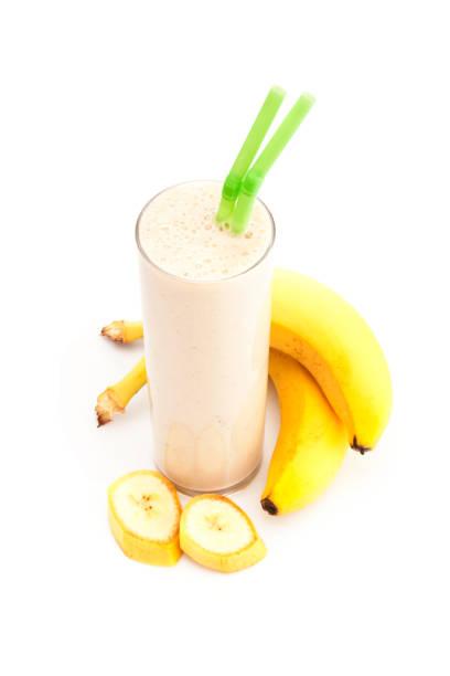 Banana smoothie glass isolated on white background stock photo