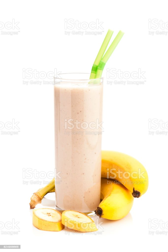 Banana smoothie glass isolated on white background stock photo