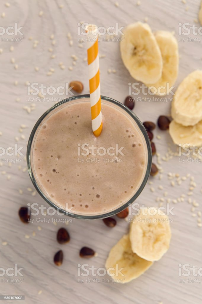 banana smoothie in a glass stock photo