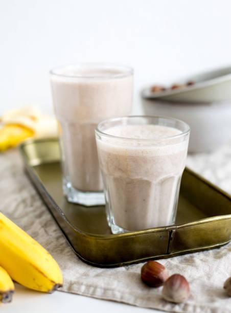Banana smoothie with hazelnut milk. Vegan food concept stock photo