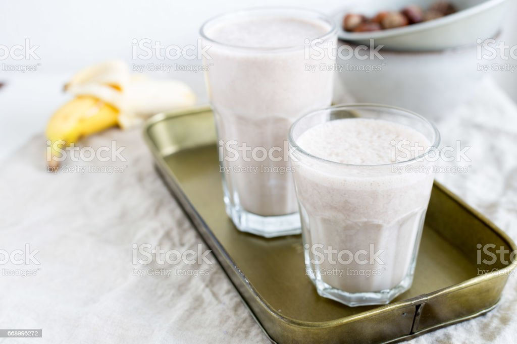 Banana smoothie with hazelnut milk. Vegan food concept stock photo