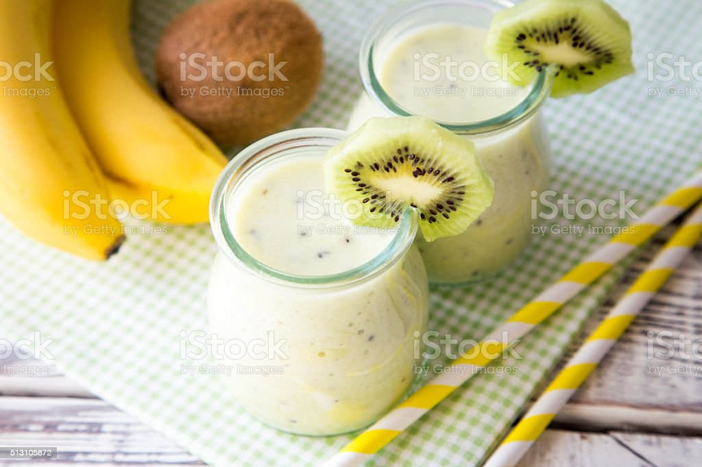 Banana smoothie with kiwi and oats stock photo