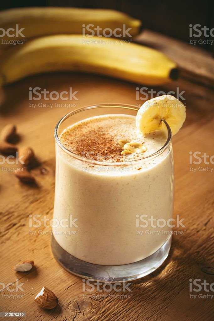 Banana smoothie with peanut butter and cinnamon stock photo