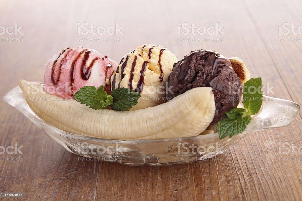 A banana split in a bowl with Neapolitan ice cream stock photo