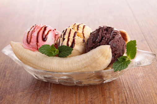 A Banana Split In A Bowl With Neapolitan Ice Cream Stock Photo - Download Image Now