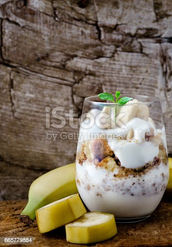 Banana yoghurt coctail on wooden table
