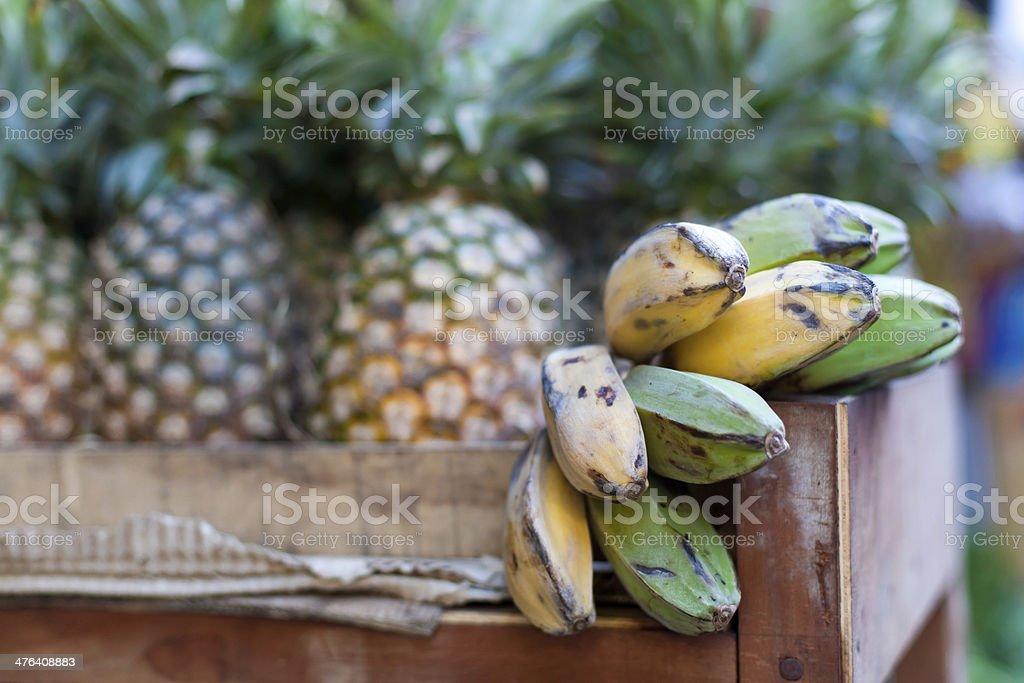 Bananas and pineapple on market royalty-free stock photo