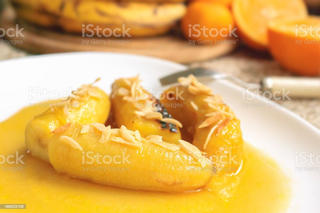 Bananas flambe with nuts stock photo