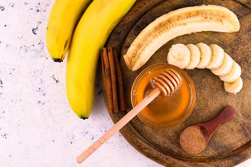 Bananas Honey Cinnamon  White Background Flat Lay Copy Space