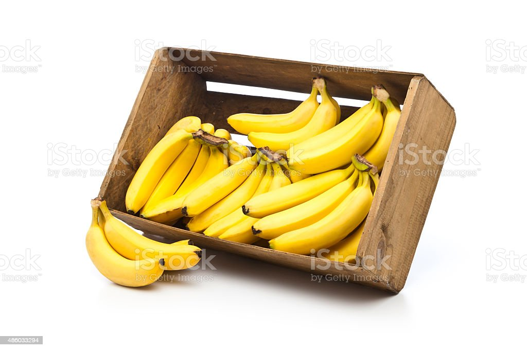 Bananas in a crate isolated on white background stock photo