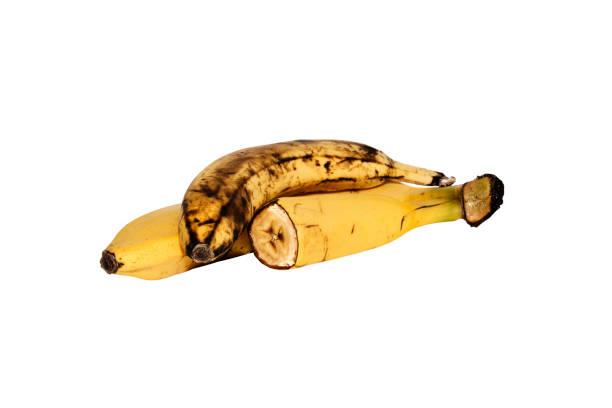 bananen, die isoliert auf weißem hintergrund, ganze banane, eine halbe banane. banane auf weißem hintergrund. спелые бананы, изолированные-на-белом. - bananeneis stock-fotos und bilder