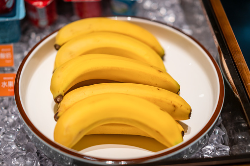 Bananas on a plate in the cafeteria