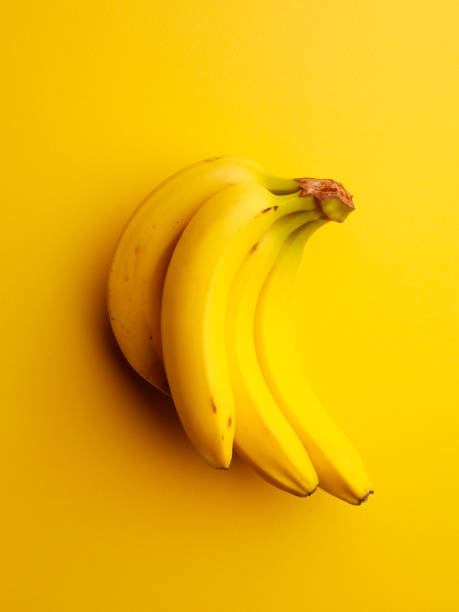 Bananas on a Yellow Background stock photo