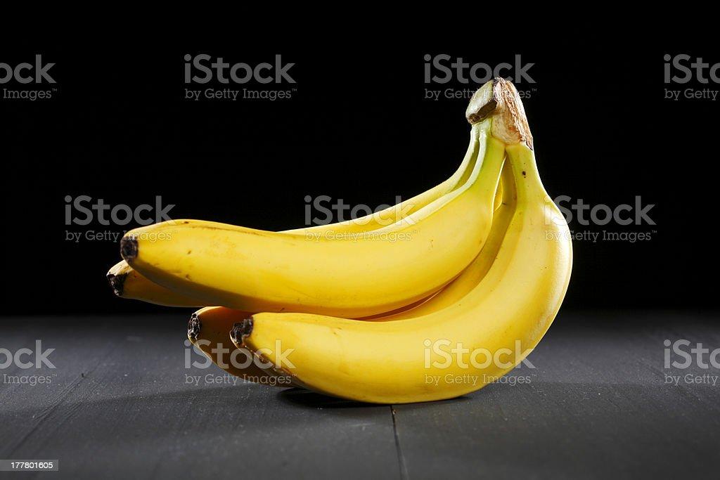 Bananas on black background royalty-free stock photo