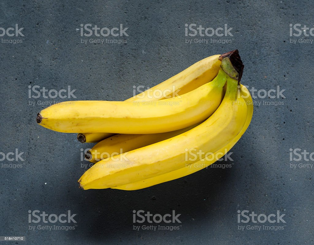 bananas on the dark table stock photo