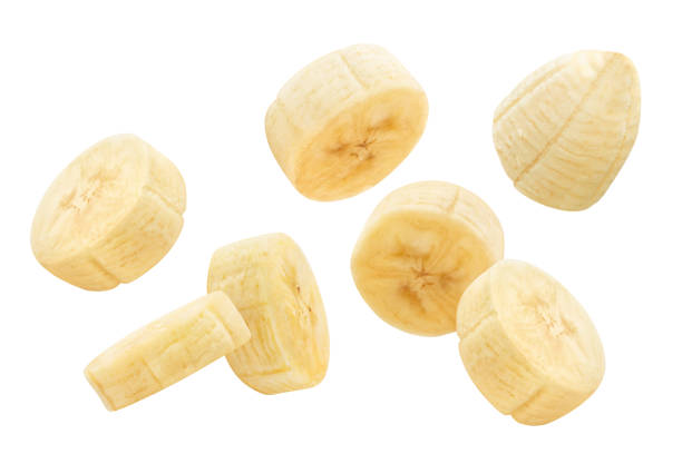 Bananas on white Flying banana slices, isolated on white background banana stock pictures, royalty-free photos & images