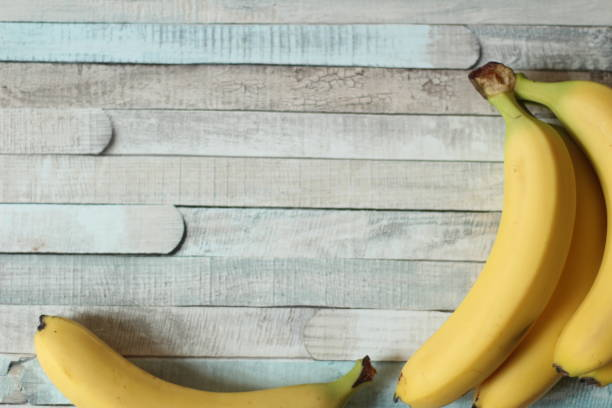 Bananas on wooden background stock photo