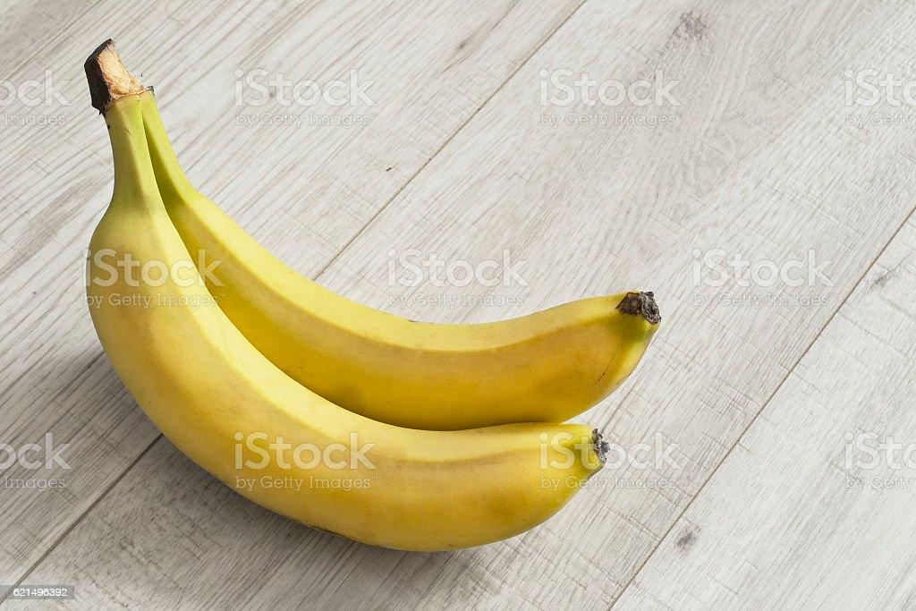 Bananas on wooden floor photo libre de droits