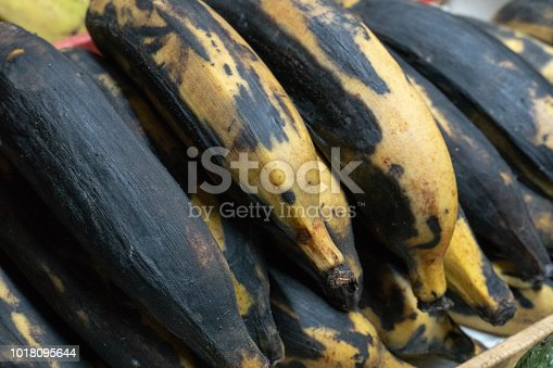 Farmers' market: Heap of ripe red bananas