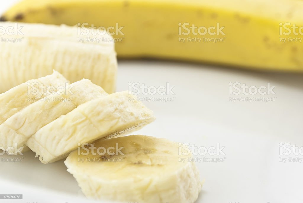 Bananas Sliced on White Plate royalty-free stock photo