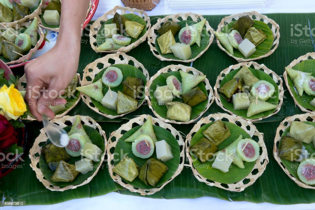 Bananas with sticky rice on green banana leaf on thai market stock photo