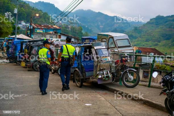 Banaue street with two police man walking ifugao philippines picture id1069517072?b=1&k=6&m=1069517072&s=612x612&h=jnbyznlevug11 gqkzhclzvc5lk lypcgpqe5lmcpoi=