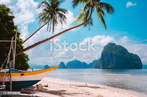 istock Banca boat on shore under palm trees.Tropical island scenic landscape. El-Nido, Palawan 1015875596