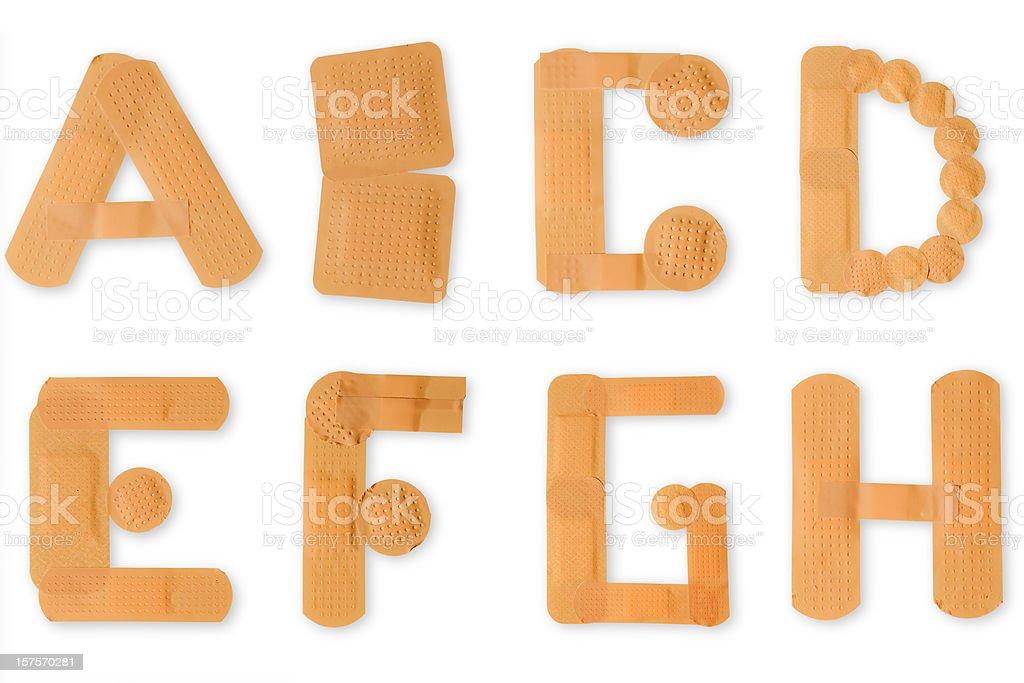 Banda ayuda alfabeto (clipping paths (Bordes de corte - foto de stock