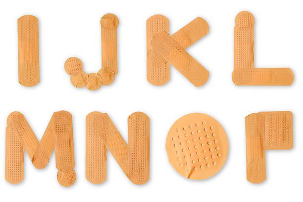 band-aid alphabet (tracés de détourage - pansement adhésif photos et images de collection