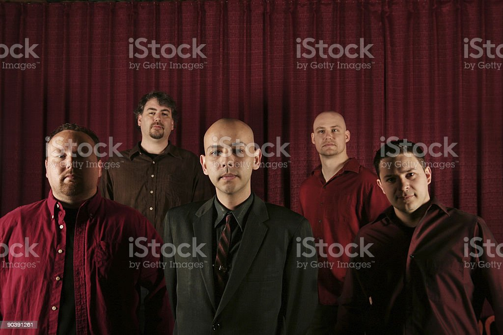band of men in ornate building royalty-free stock photo