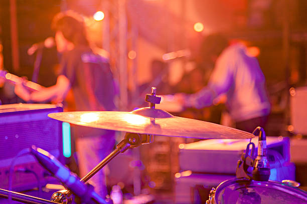 Band on stage at a live concert Band playing at a live concert, shallow depth of field country and western music stock pictures, royalty-free photos & images