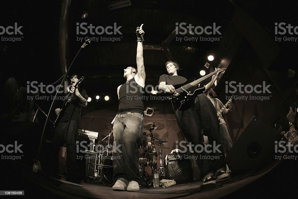 Band performing on stage, fisheye royalty-free stock photo