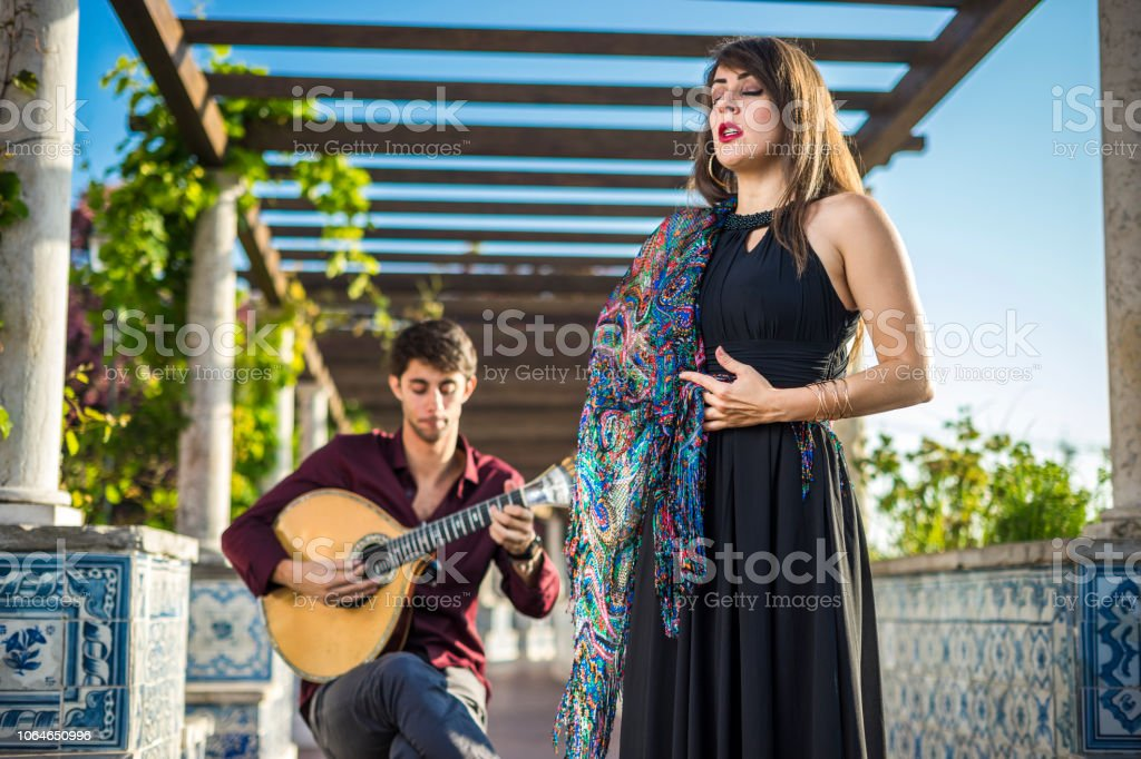 Band performing traditional music fado under pergola with azulejos in Lisbon, Portugal Band performing traditional music fado under pergola with portuguese tiles called azulejos in Lisbon, Portugal Adult Stock Photo