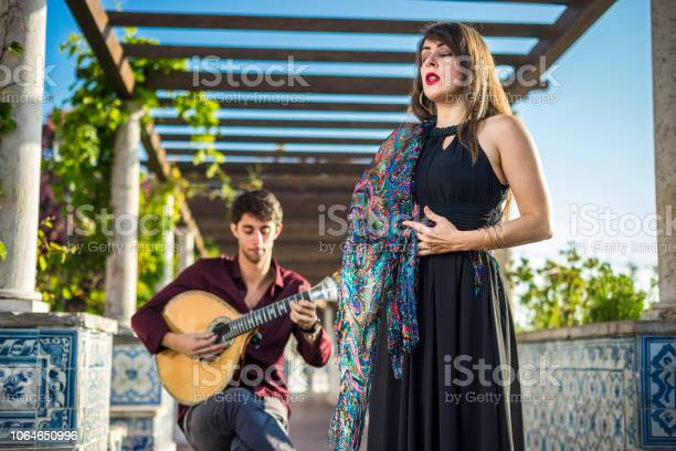 Band Performing Traditional Music Fado Under Pergola With Azulejos In Lisbon Portugal Stock Photo - Download Image Now