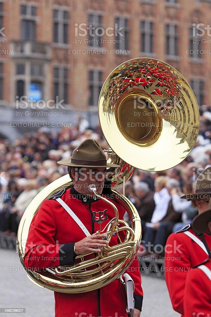 Band reflection as sousaphone player takes a break stock photo