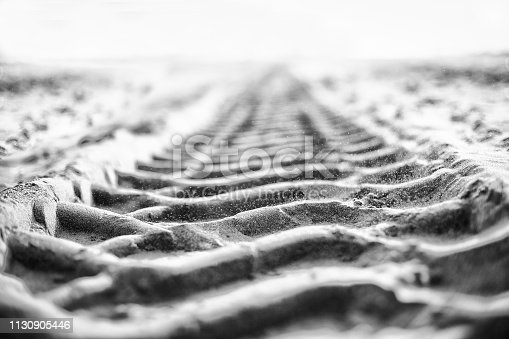 istock Band tracks on the sand background 1130905446