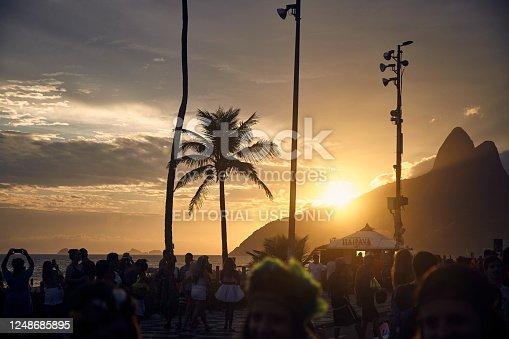 Banda de Ipanema street carnival bloco party at sunset in Ipanema, Rio de Janeiro, Brazil.