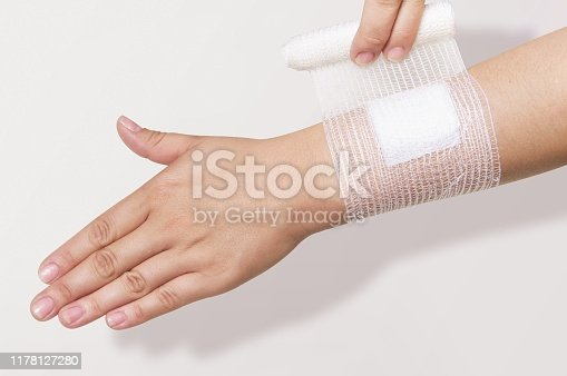 Bandage on injured human arm. Proper applying as first aid treatment for arm fractures.
