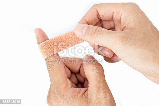 istock Bandage on the index finger isolate background 868343046