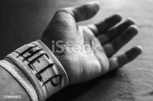 1091817198 istock photo Bandaged forearm of a man on self-harming behavior in mental health disorders 1208954922