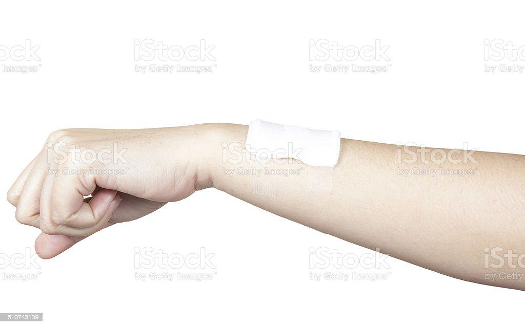 Bandaged hand isolated on white stock photo