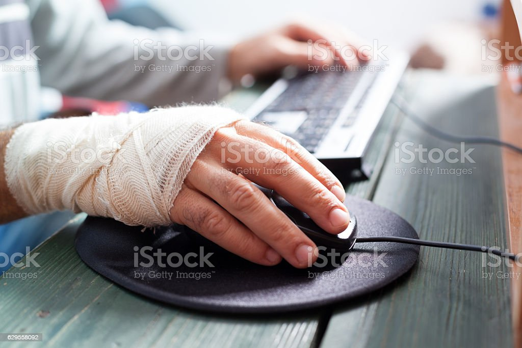 bandaged hand on mouse - Photo