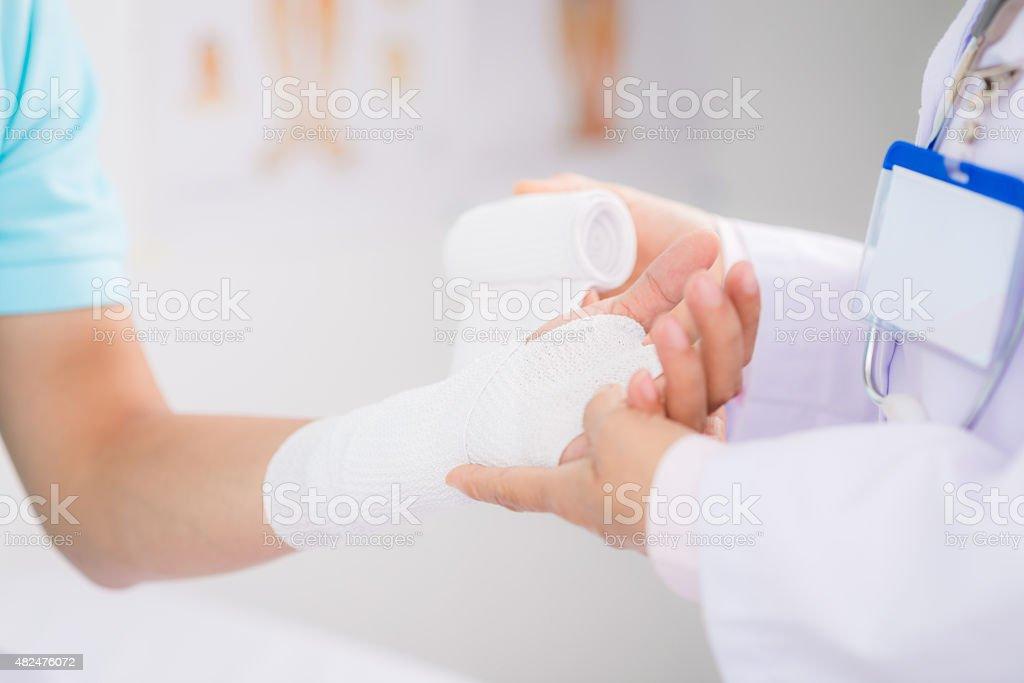 Bandaging wrist stock photo