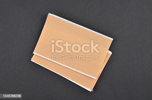 istock Band-aid on black background 1045286256
