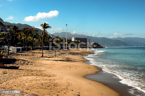 A gorgeous early morning view of Banderas Beach with El Malecon boardwalk lined with palm trees