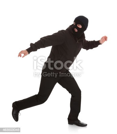 istock Bandit In Black Mask Running Away 463503045
