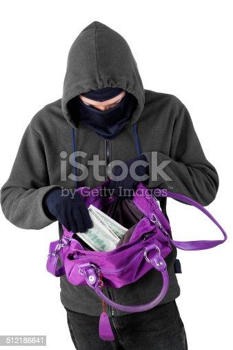 istock Bandit taking money from handbag 512186641