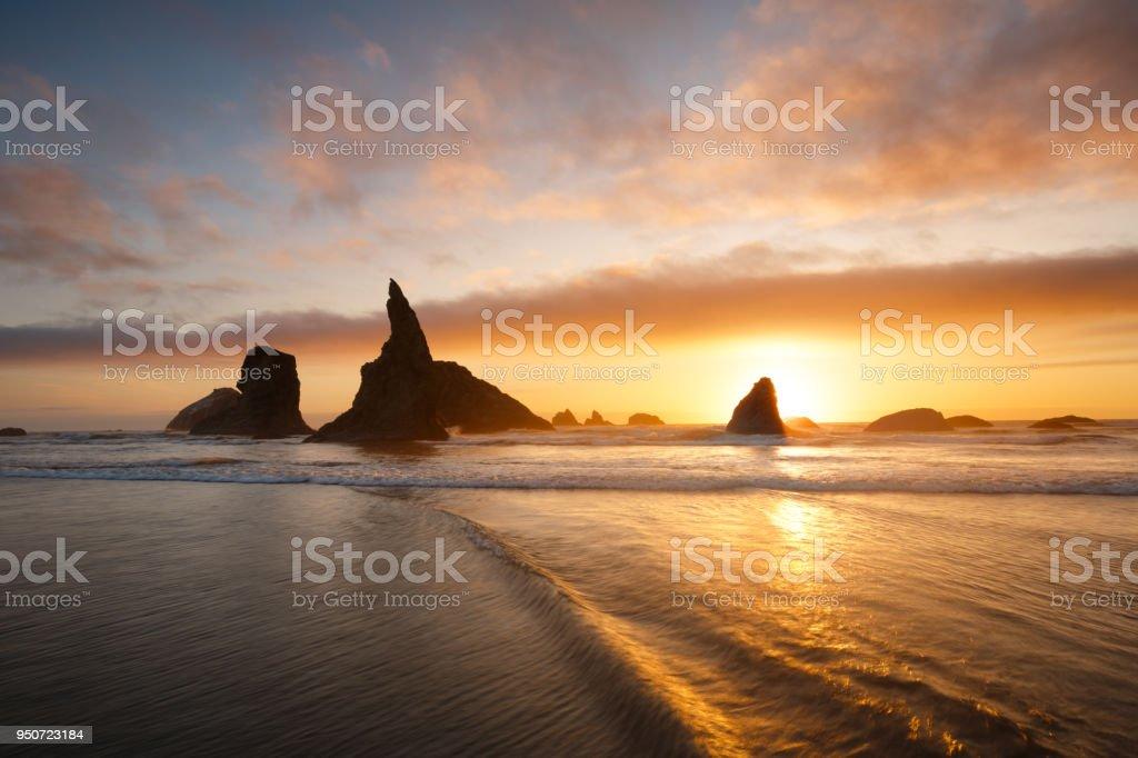 Bandon beach sunset, Oregon Coast stock photo